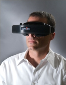 photo of human wearing virtual reality headgear